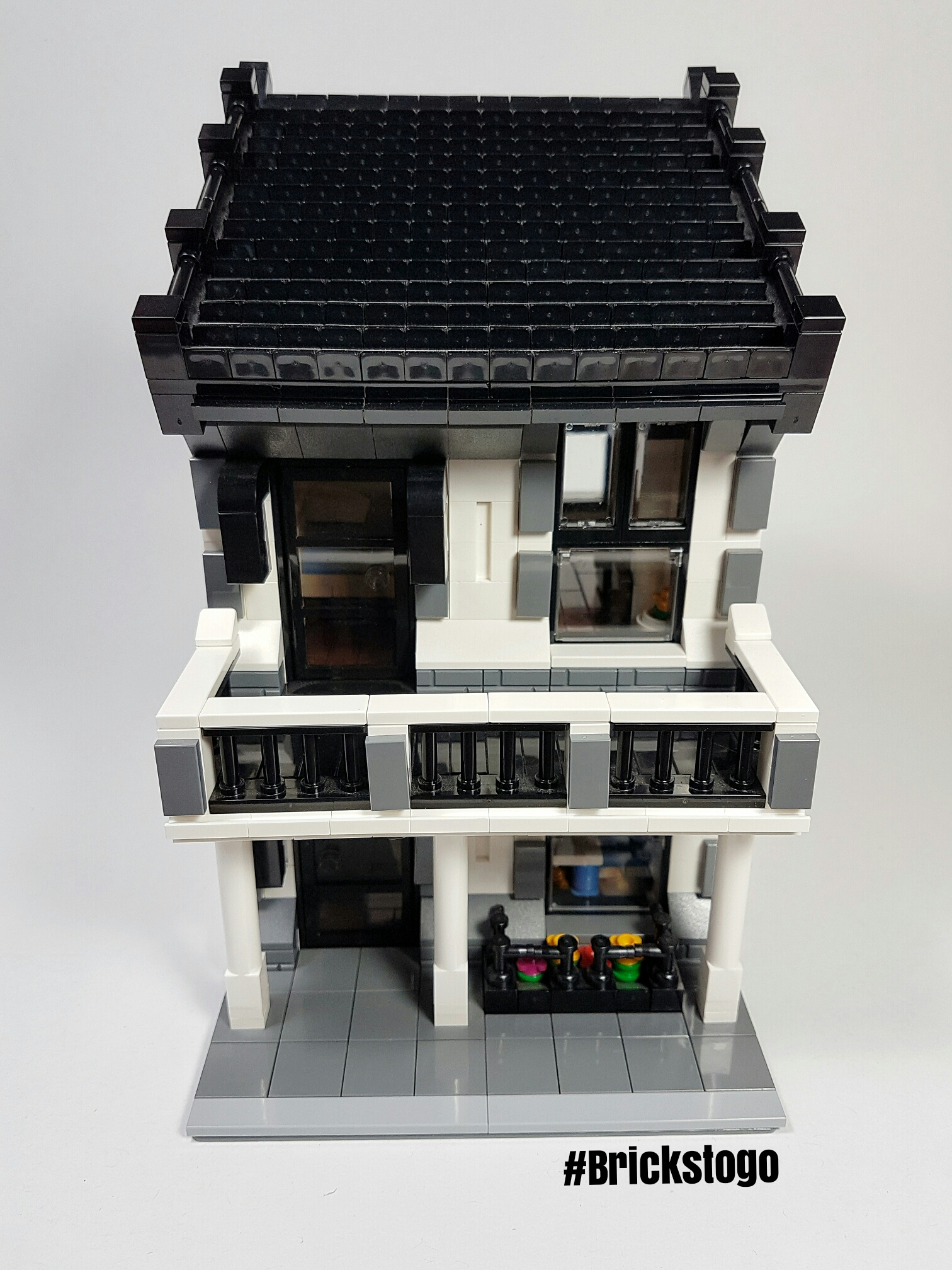 Front view of white Lego house MOC