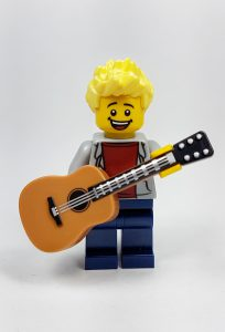 Lego mini-figure holding an acoustic guitar
