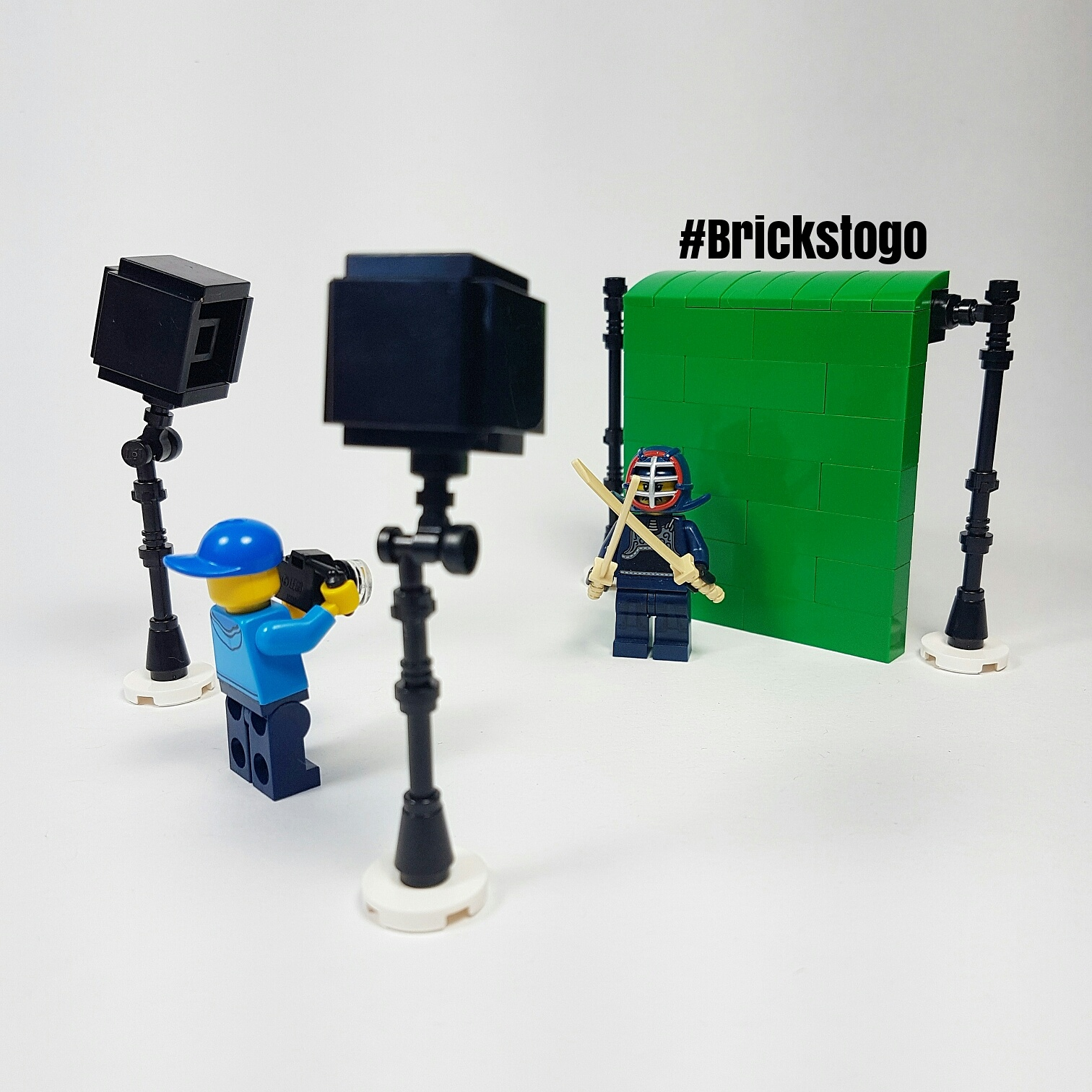 Lego photographer taking green screen photo of a samurai
