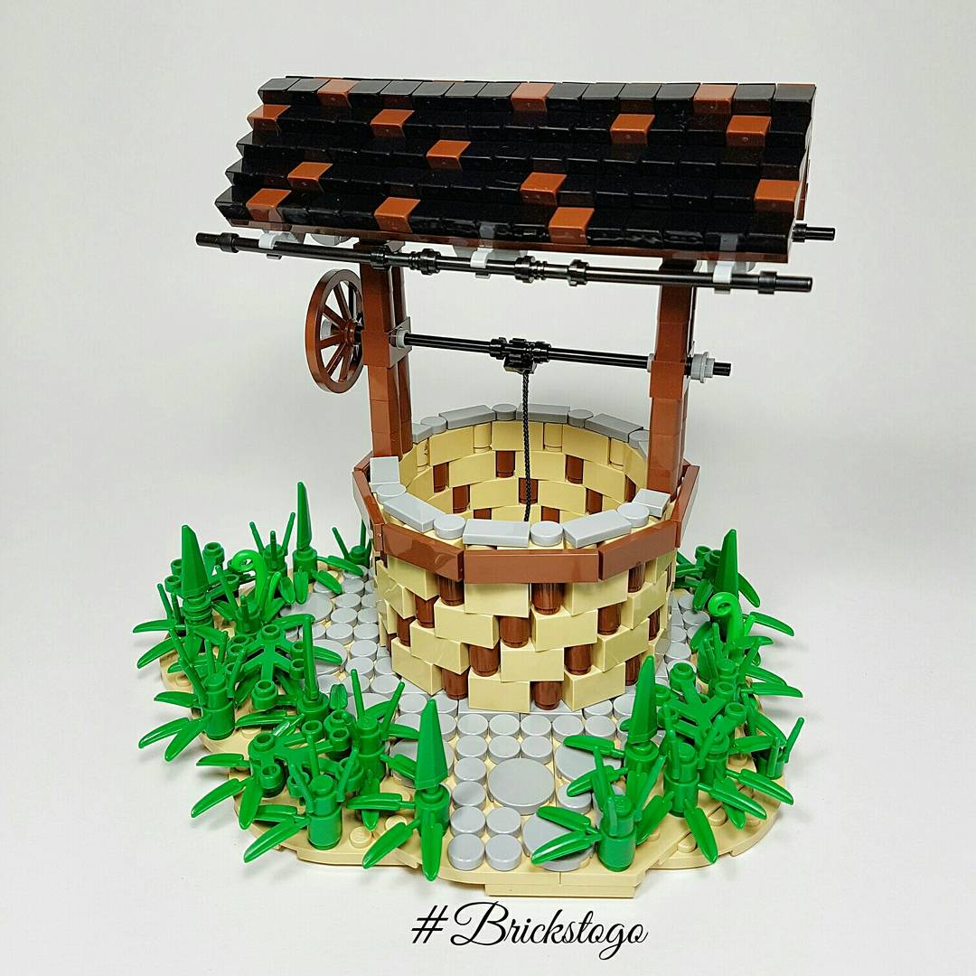 Old Lego drinking water well with stone pathway